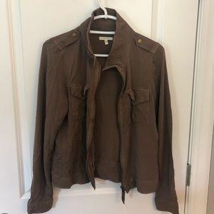 Maurice's light brown jacket